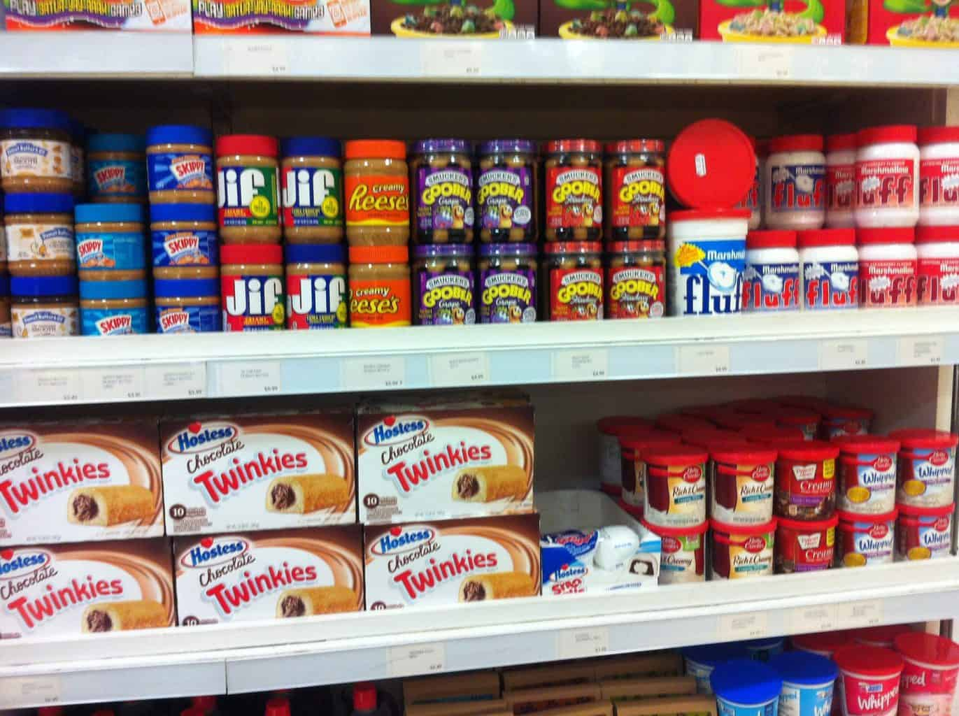 Store shelves with American food items on it such as Jif peanut butter Twinkies and Marshmallow Fluff
