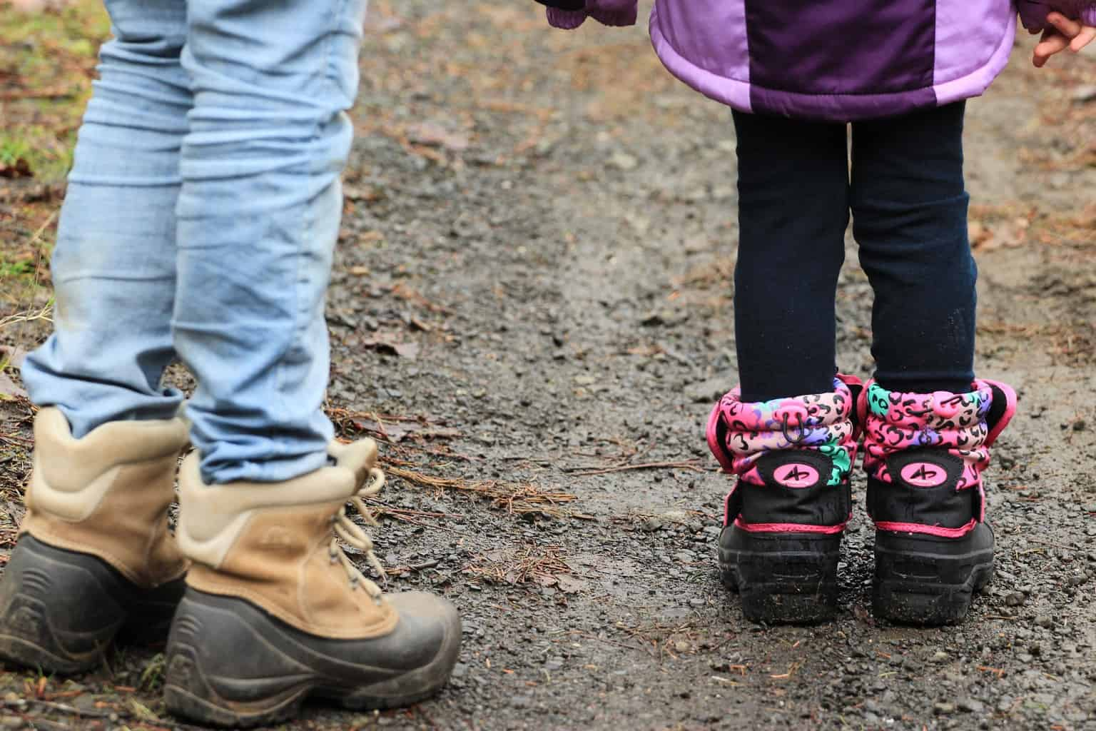 Two children in walking boots