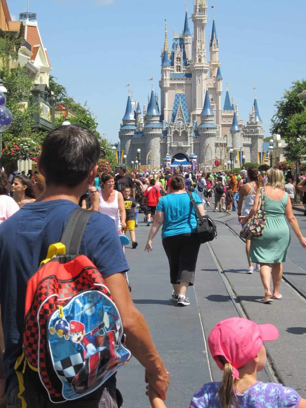 father-and-daughter-walking-down-main-street-disney-world
