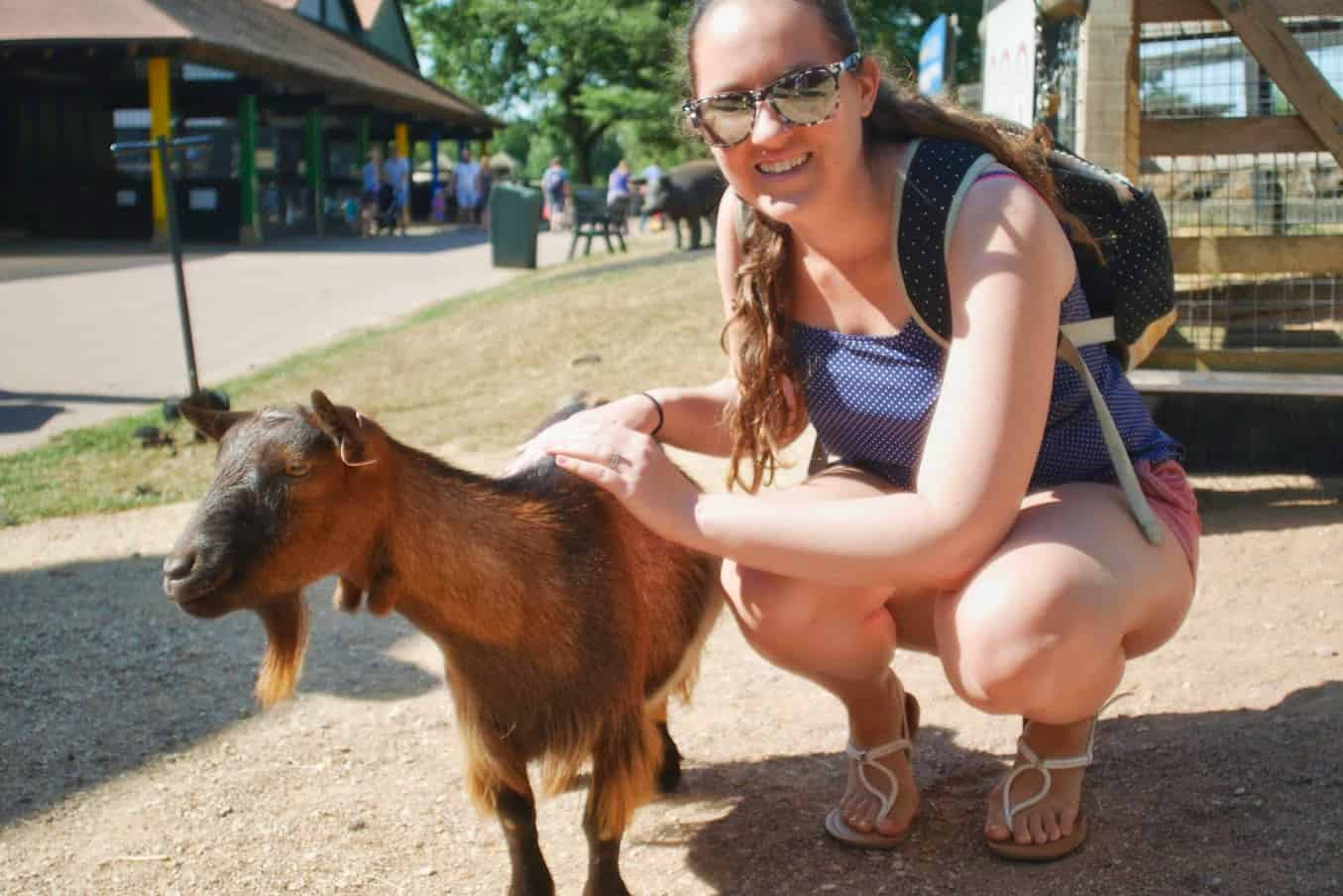 Kalyn kneeling with a goat