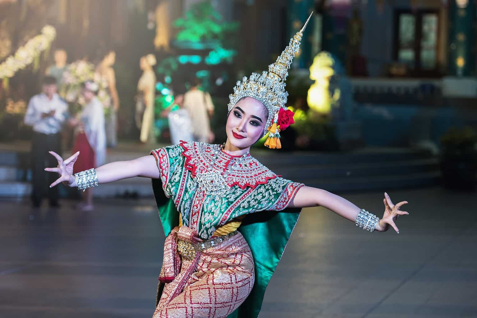 Dancer in colorful clothes and intricately designed headwear