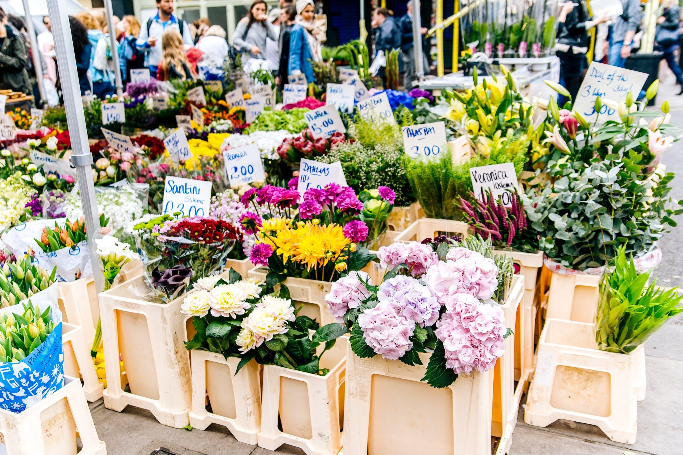 Flowers arranged in buckets at a flower market