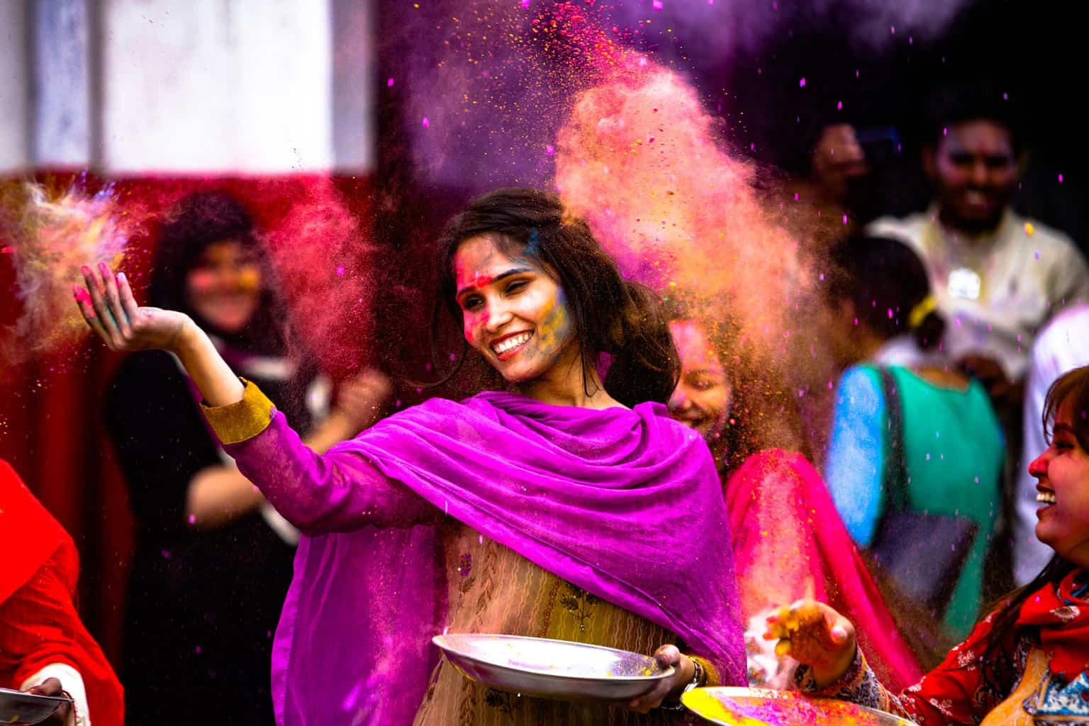 Lady in colorful clothes with spices in the air