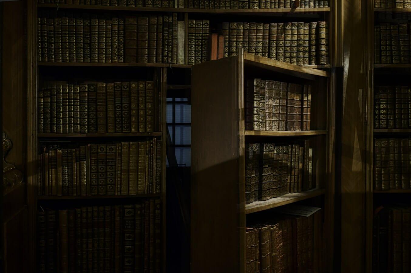 Hidden room behind open bookcase