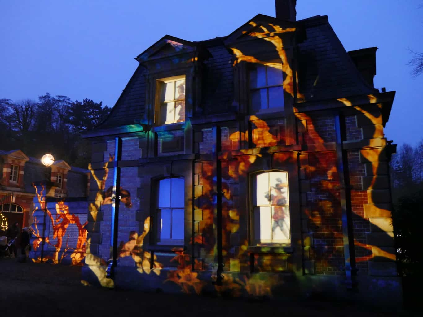 A projection on the stables at Waddesdon Manor at Christmas