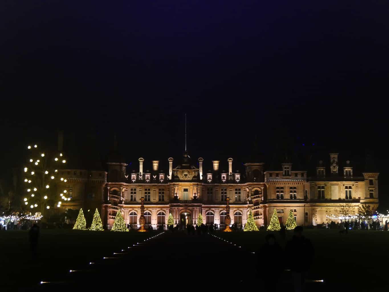 Waddesdon Manor lit up at night at Christmas