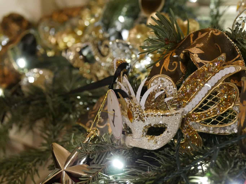 A mask on a Christmas tree inside Waddesdon Manor