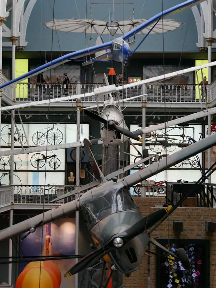 Three planes hanging from the roof of the National Museum of Scotland