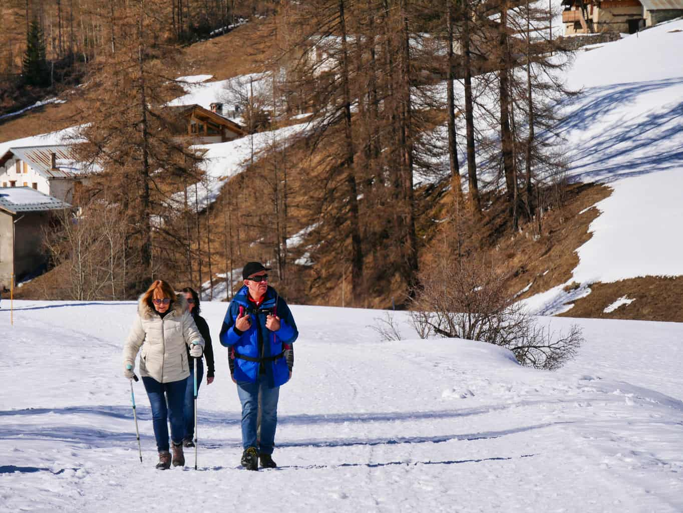 People walking in snow in valley between Les Arcs and La Plagne in the French Alps