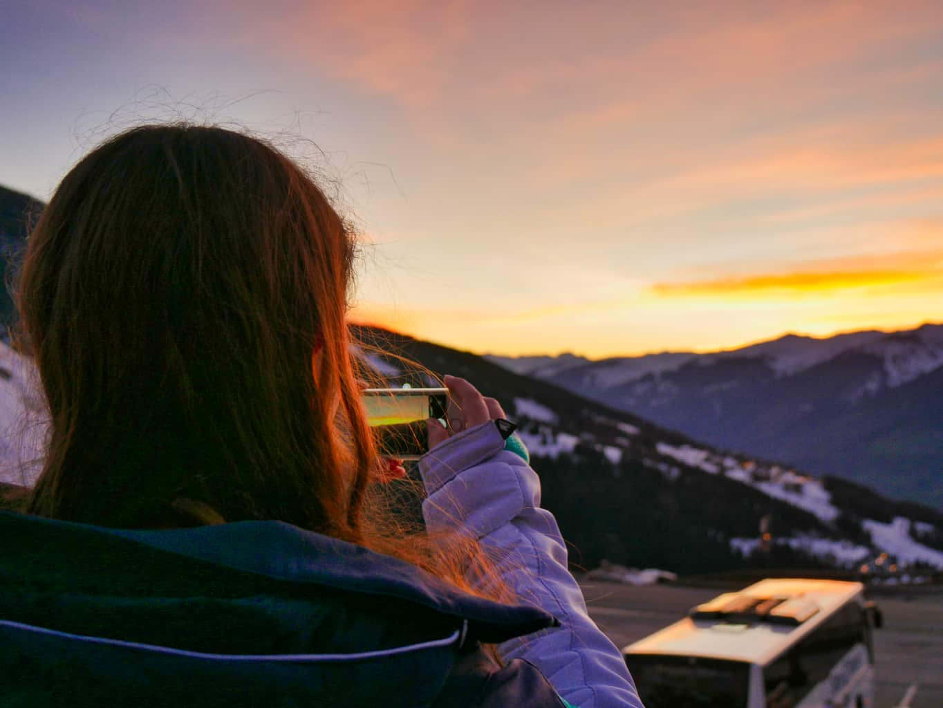 Kalyn taking a picture of the sunset over the French Alps