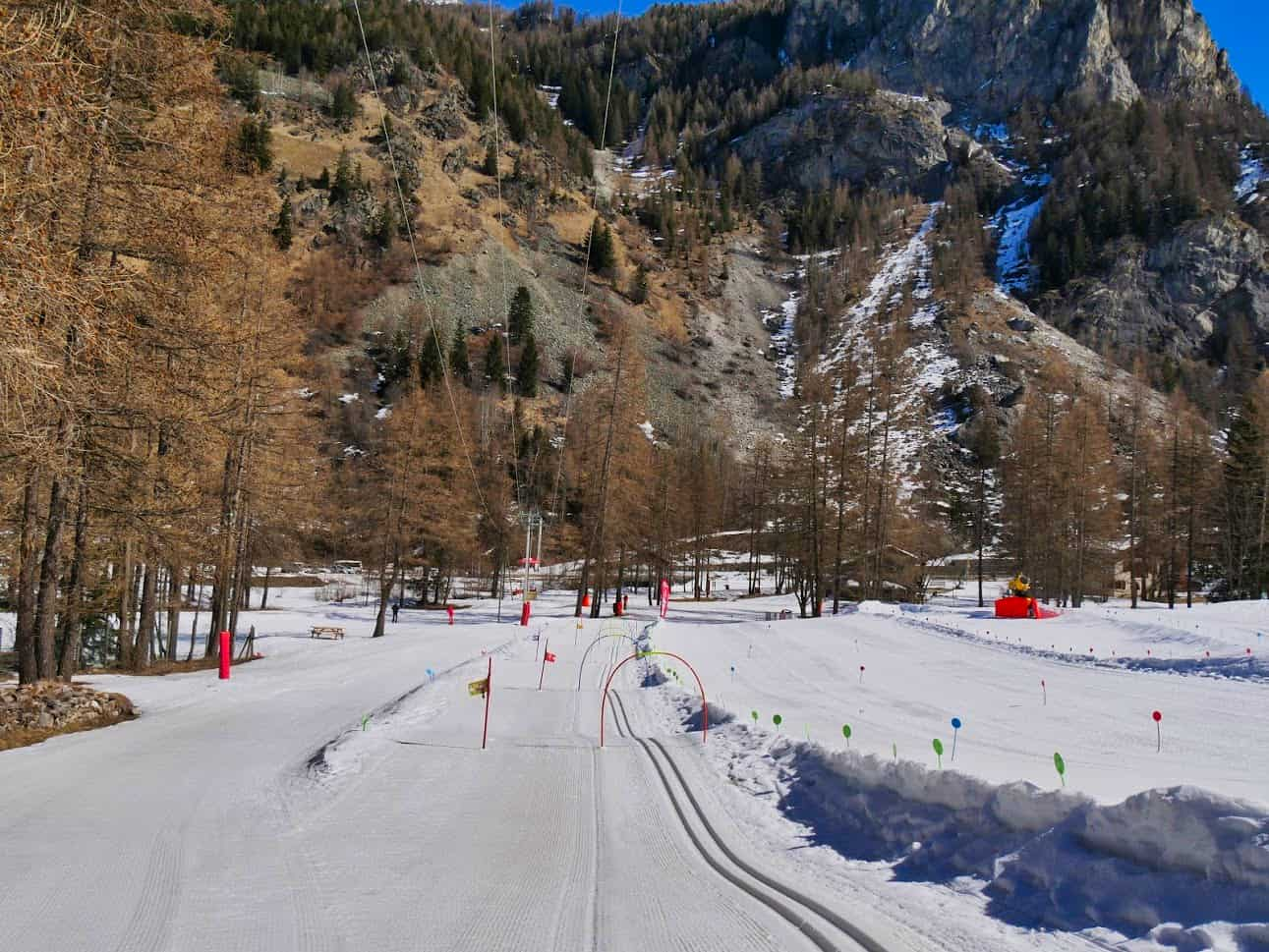 Beginners Nordic Ski area with slalom flags and arches with bells underneath