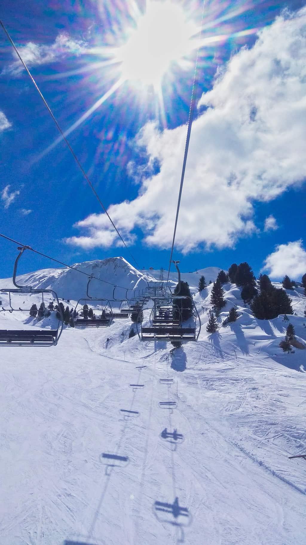 Chairlift going up ski slope Les Arcs