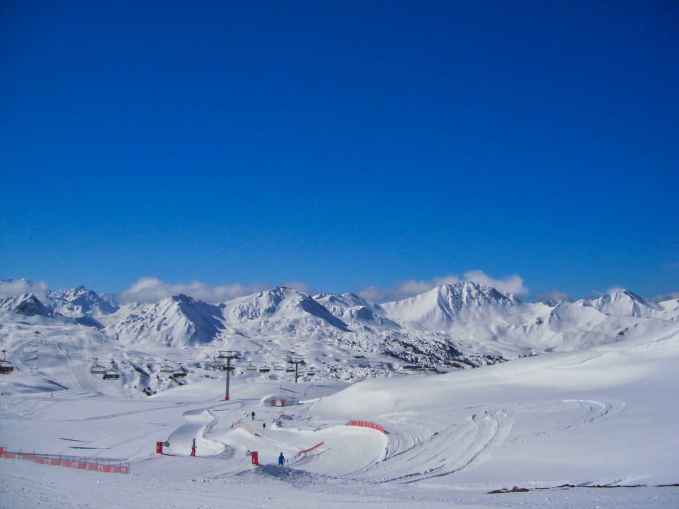 Ski slopes in Les Arcs with deep blue sky