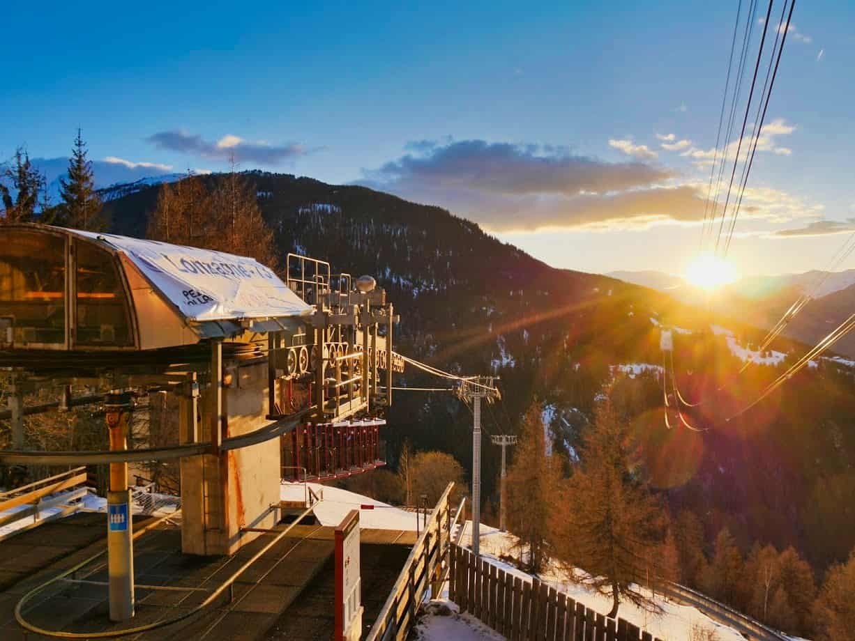 Entrance to Lonzagne bucket lift from Peisey down the mountain with sunset in the background