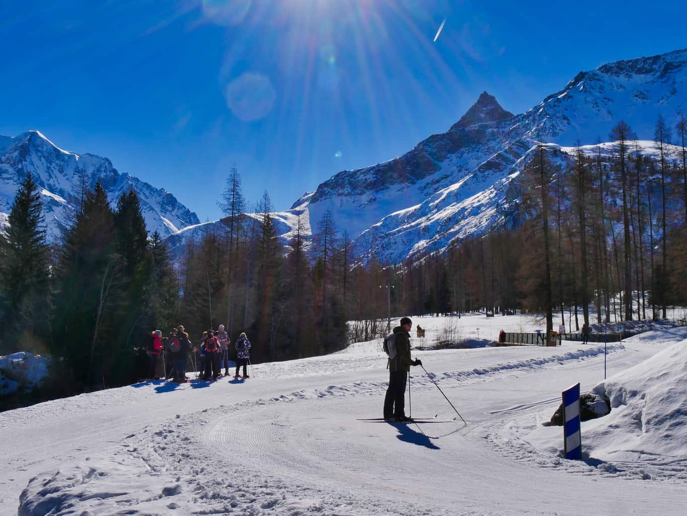 Nordic Ski area in Paradiski with a cross-country skier and walkers surrounded by snowy mountains