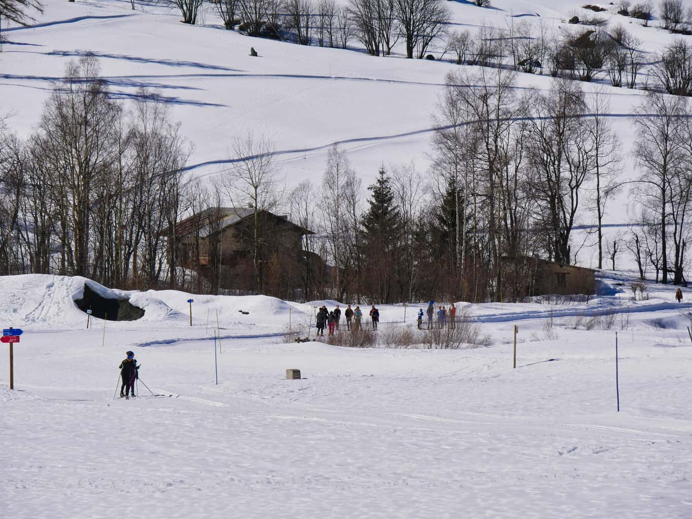 Nordic Ski Area in Peisey-Nancroix covered in snow with people skiing and walking