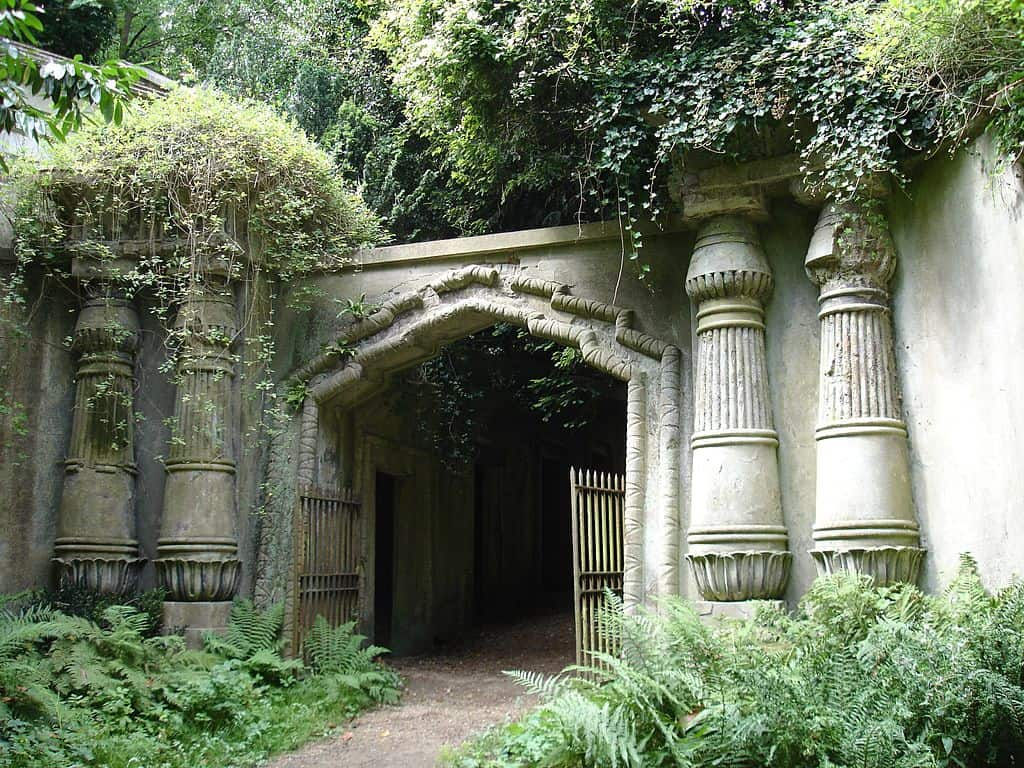 Egyptian Avenue in Highgate Cemetary in London arches covered with greenery