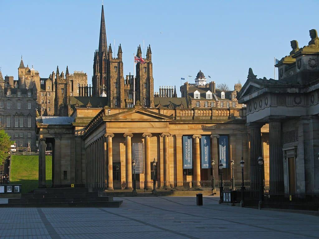 Scottish Natinal Gallery in Edinburgh. Old building with stone pillars and blue sky.