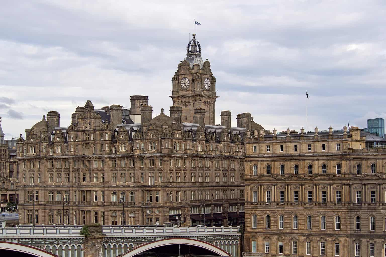 The Balmoral Hotel in Edinburgh with grey clouds behind
