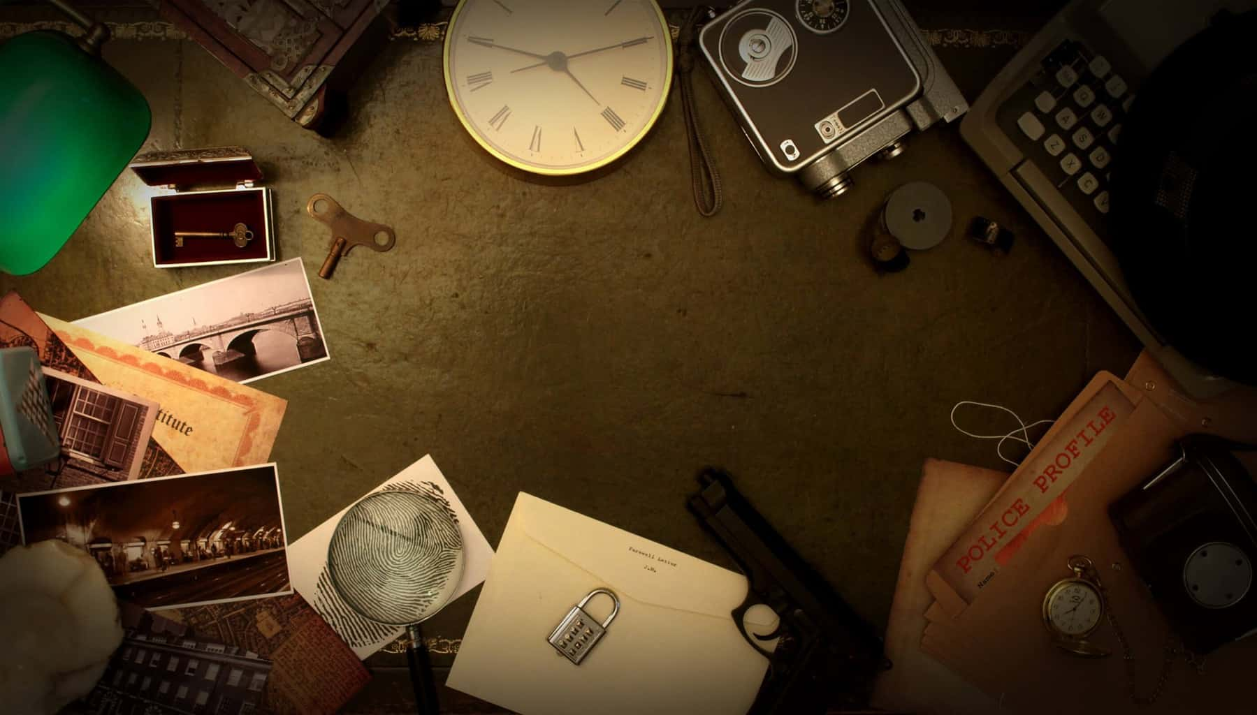 Escape room game props on a table, such as a clock, photographs, papers, and an audio recorder