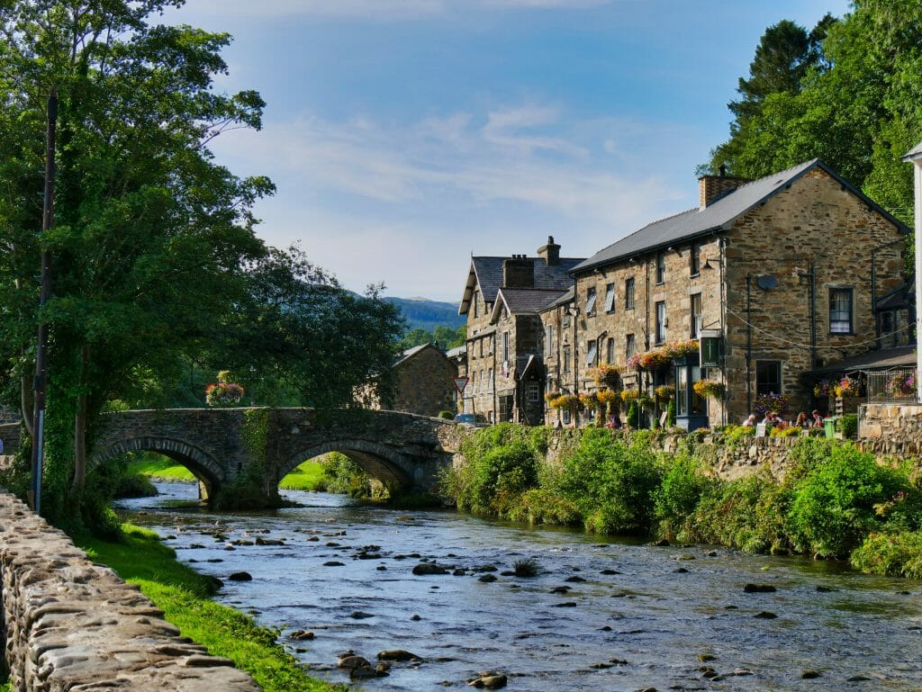 River in Beddgelert Wales with stone houses to the side