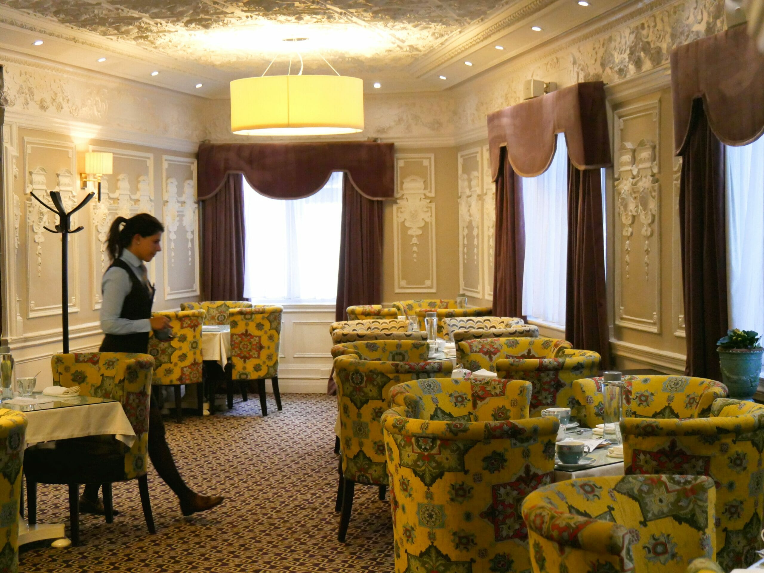 Inside of St. Ermin's Hotel with chairs and tables laid out for afternoon tea