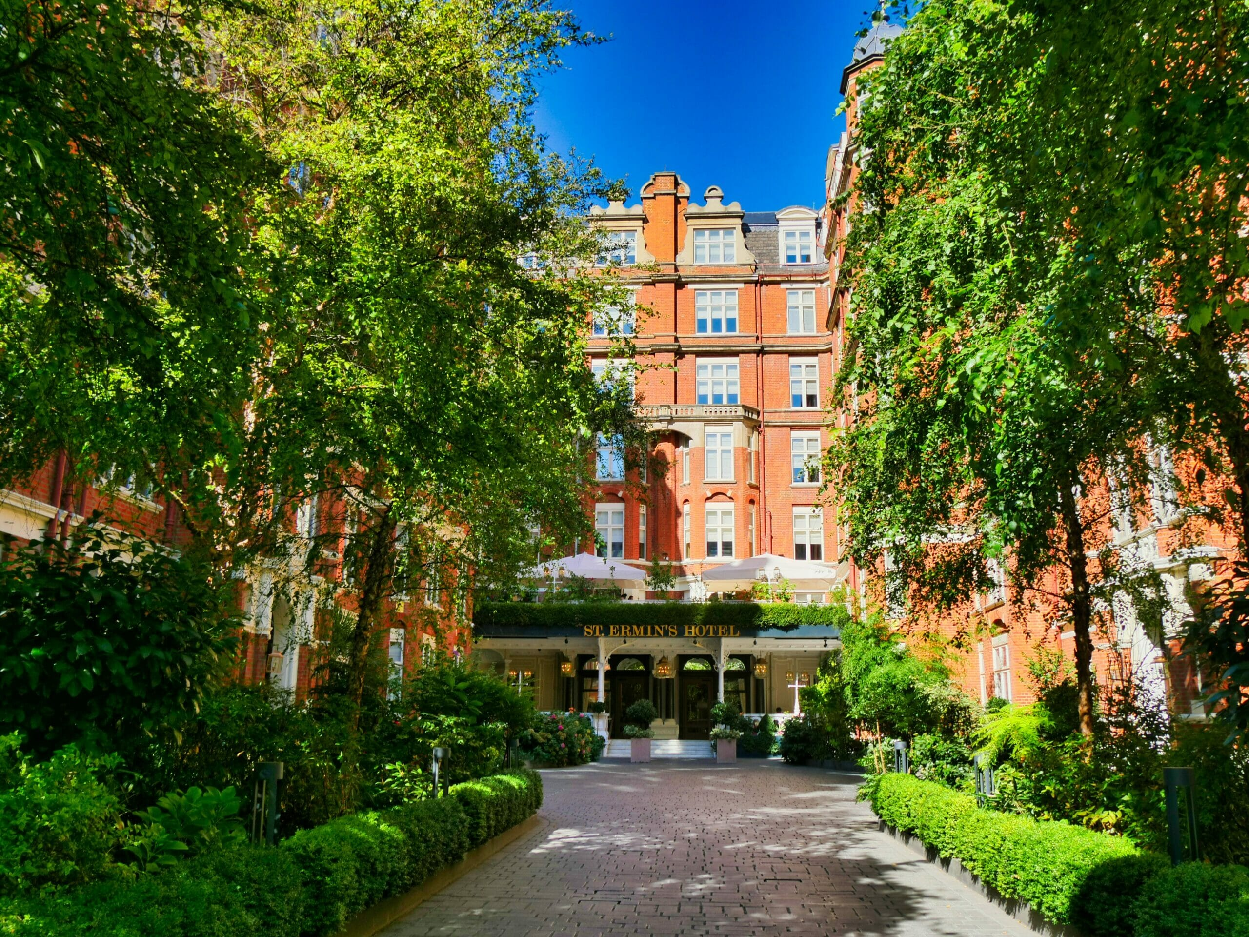 Front of St. Ermin's Hotel with green tree's either side