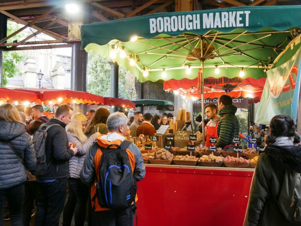 People milling around a food stand at Borough Market London
