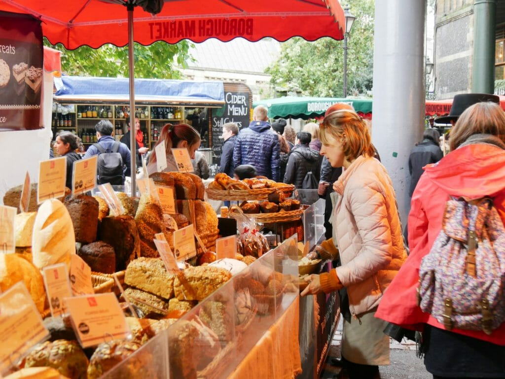 A bread shop at Borough Market London with a lady being served