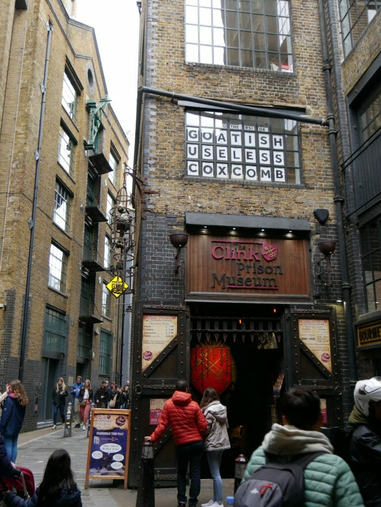 The Clink Prison Museum London Bridge Exterior with a hanging skeleton in a cage
