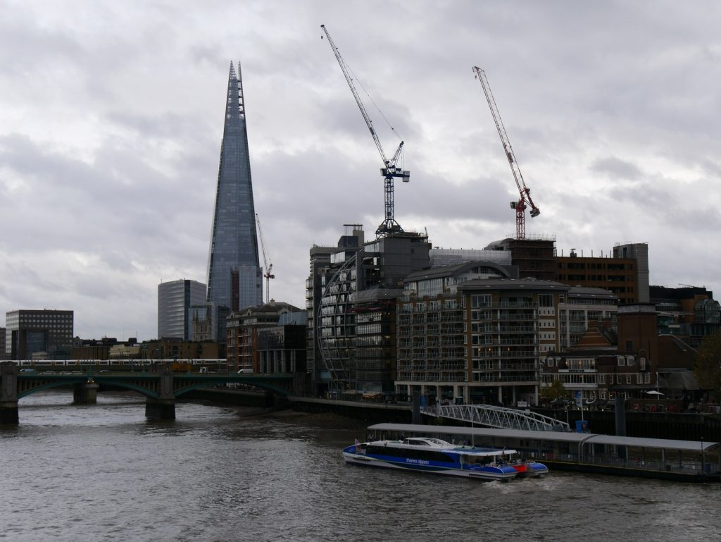 A boat tour on the River Thames with The Shard in the background at London Bridge