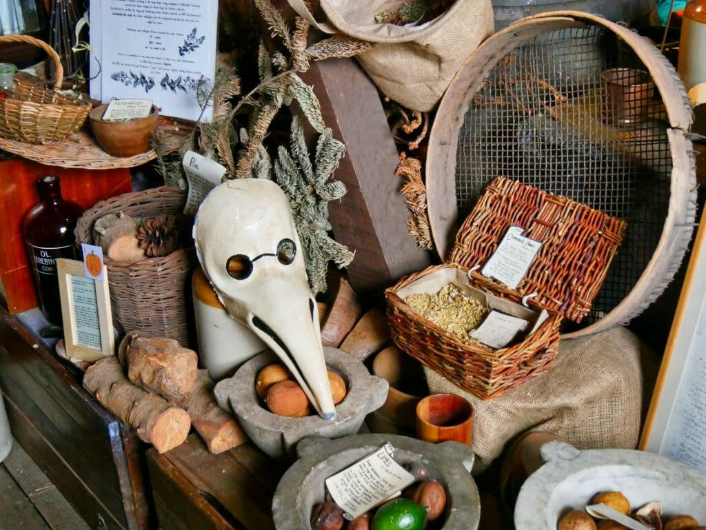 A Plague Doctor mask on a table of herbs at The Old Operating Theatre in London Bridge