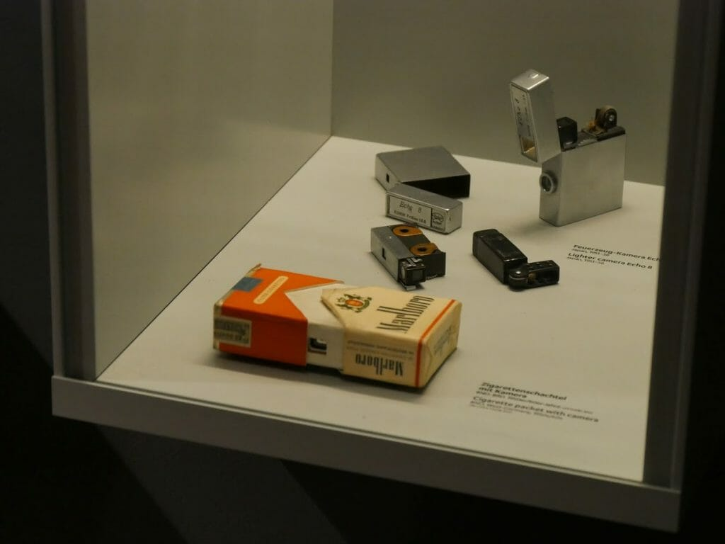 A display case with a camera disguised as a cigarette packet