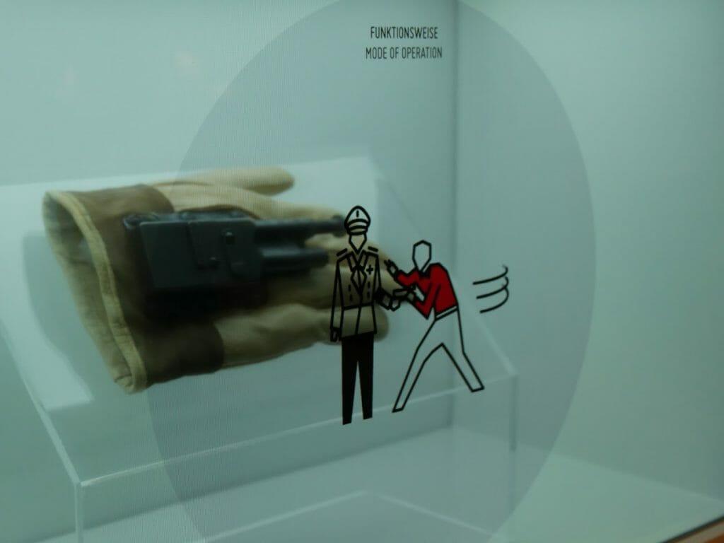 A gun hidden in a glove with an information screen over it