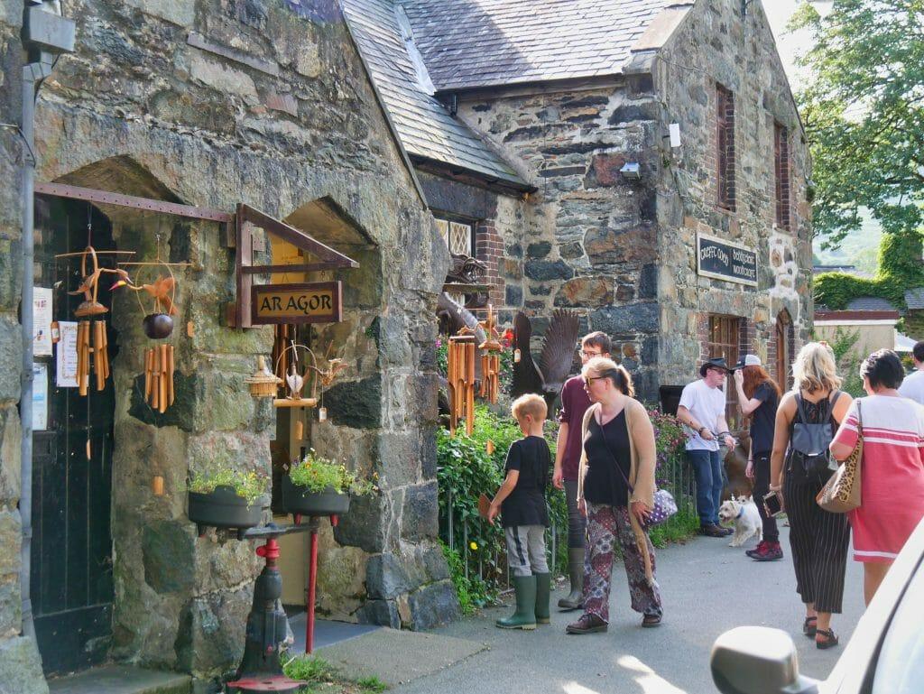 People outside stone shops in Beddgelert, Wales
