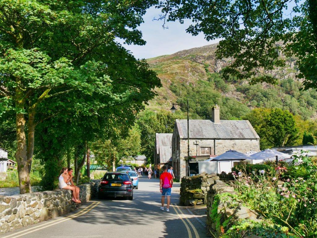 A road in Beddgelert, Wales, with people walking down it