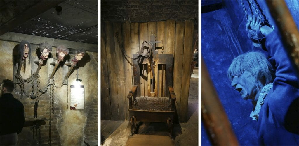 Beheaded heads on poles, torture chair, model of a man in a prison cell at Clink Prison Museum