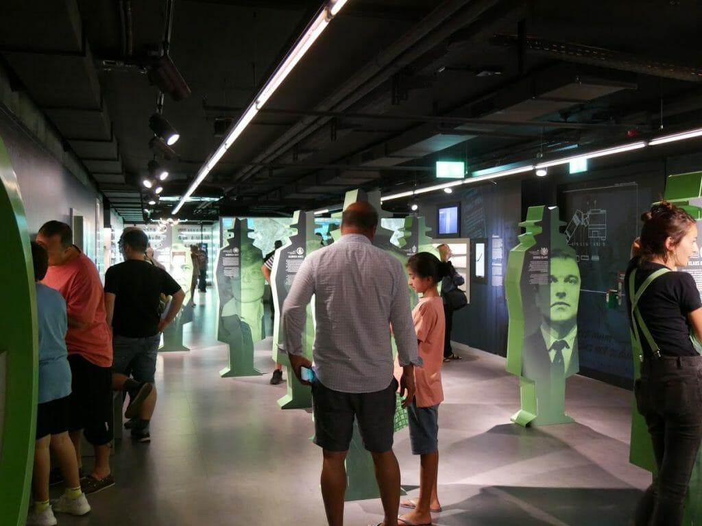 Inside the German Spy Museum, Berlin, with people looking at displays