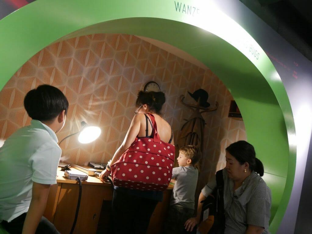 Kids looking for bugs in the German Spy Museum, Berlin