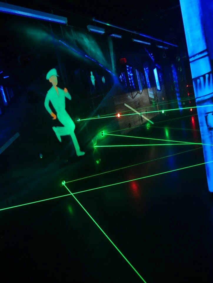Green lasers going across a room in the laster game in the German Spy Museum, Berlin