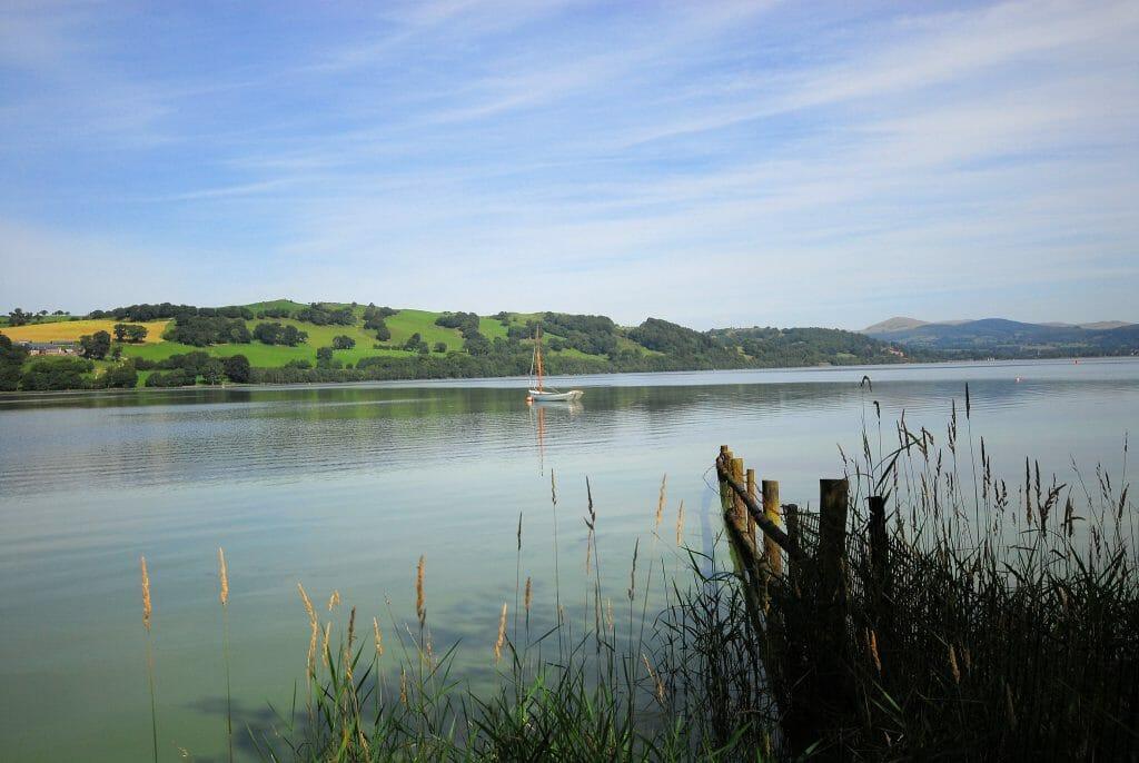A boat on a calm Lake Bala in Wales