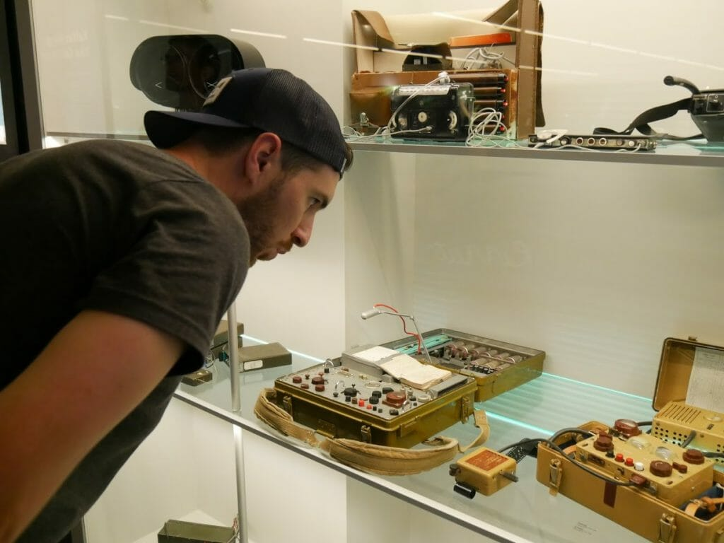 A man looking at a display at the German Spy Museum, Berlin