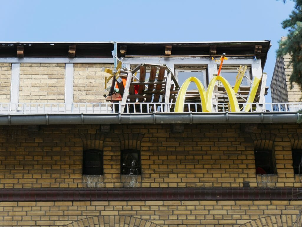A stolen McDonald's sign on a rooftop in Berlin