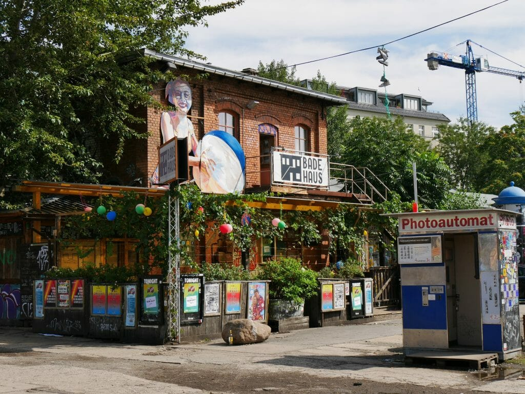 A bar surrounded by posters and greenery on the Berlin secret food tour