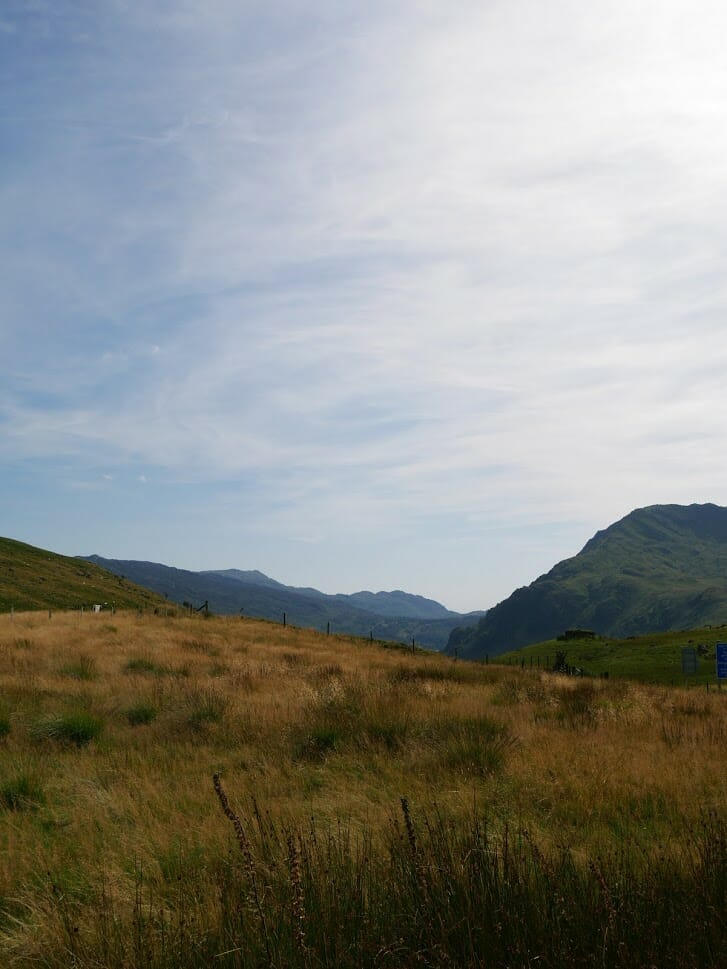 A valley through North Wales with mountains either side