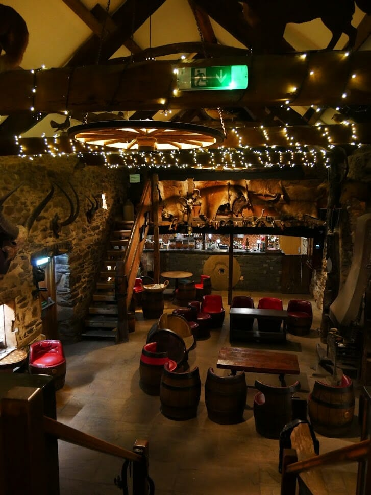 Inside the bar at The Quiet Site Lake District, with lots of rustic and agricultural decor