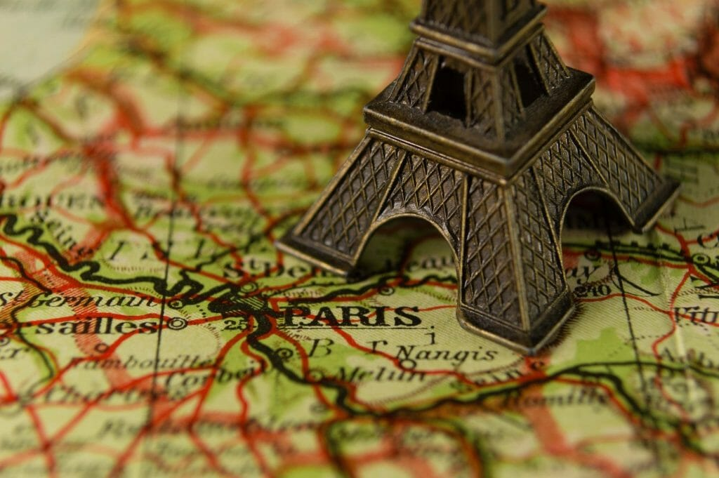 A map of Paris with a mini Eiffel Tower on it