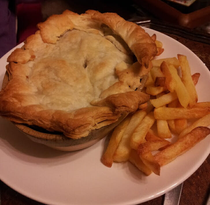 Pie and chips on a plate