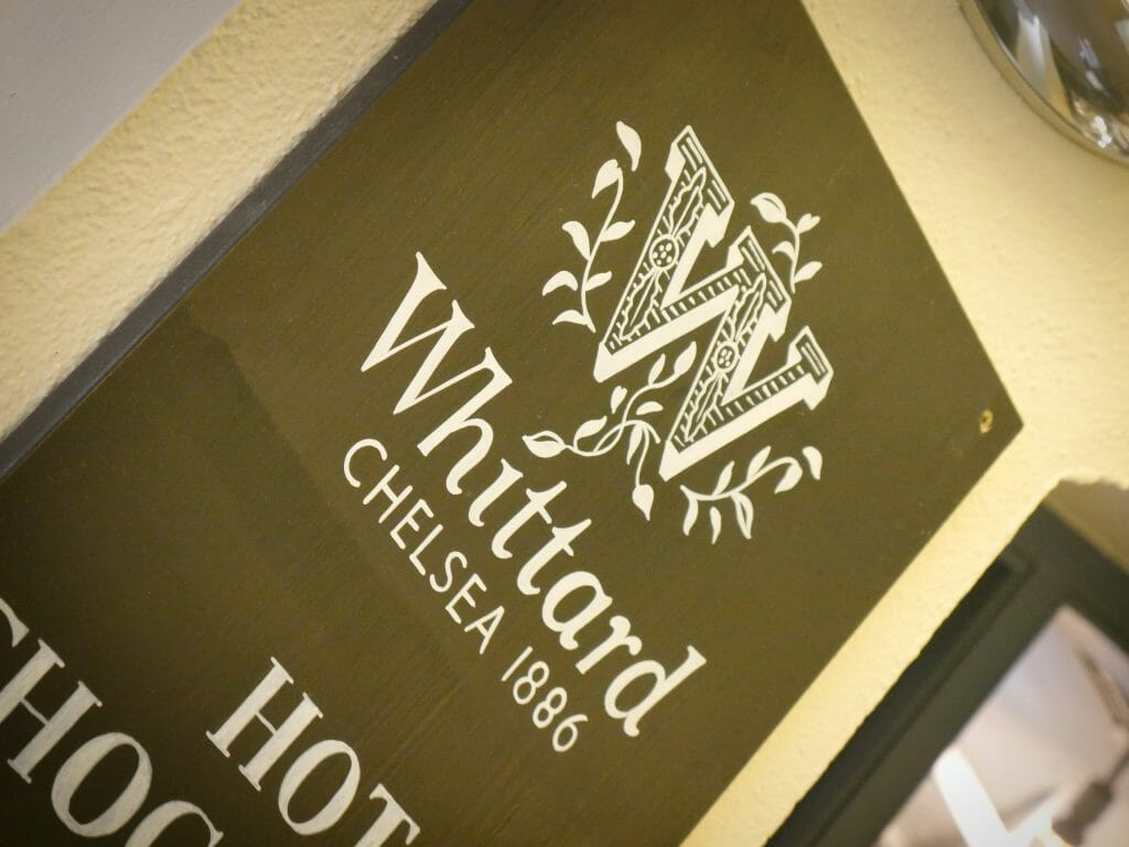 A sign for Whittard Chelsea outside the entrance